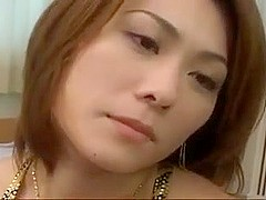 Japanese cougar is in stockings while fucking