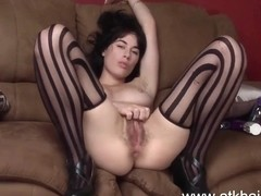 Hairy Olive fucks a toy