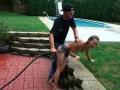 Lovely teen blonde gets sprayed outdoors