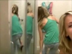Two girl girlfriends in a changing room