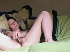 girl gets naked and masturbates her hairy pussy with a vibrator on her bed