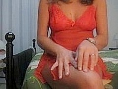 Woman in red nightgown gets naked