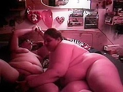 Two chubby lesbians with toys
