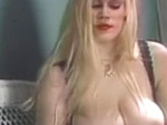 Large breasts golden-haired playing with her toys