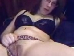 Chubby bitch with glasses masturbating on webcam