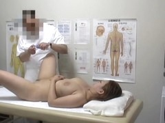 Nasty masseur rubbing his young client's pussy