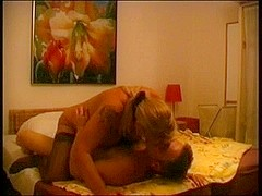 A chubby old milf sits on a stiff cock in a private room