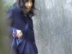 Cute Asian schoolgirl skirt sharked after texting.