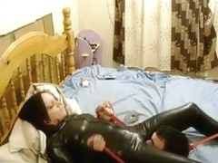 Tied up serf in latex