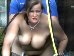Busty mature brunette tugging on a dick
