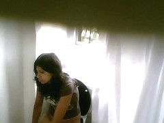 Cute young girl with nice ass pissing on the hidden cam