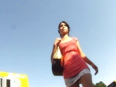 Shameless brunette attracts men's attention in upskirts video