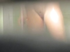 Spy cam shooting adorable shaved cunt in the shower