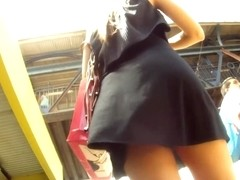 That black dress of hers won't be a problem for a voyeur
