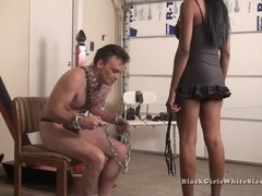 Humble white guy is tied up by a sexy ebony woman