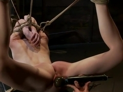 Severely bound into a brutal hogtie and pulled to the breaking pointMade to cum over and over!