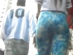 Girl in colorful blue tight pants