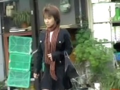 Attractive Asian milf with no panties sharked in public