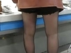 Black stockings upskirt in supermarket 1