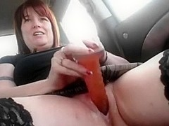 Busty redhead masturbates in the car