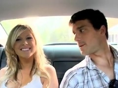 Cute blondie starts giving a head in a car