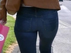 Candid ass in tight jeans tan leather jacket