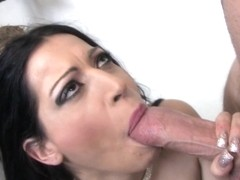 Busty Latin whore engulfs a big meat hose