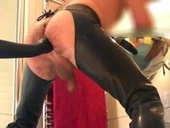Male slave in latex fisted and milked by mistress