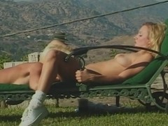 Gorgeous blonde lesbians in the outdoor sex scene