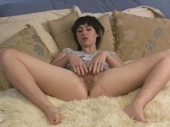 Hairy amateur model Barb uses a toy on her pussy