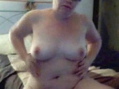 Mature fat blonde masturbating in front of the camera