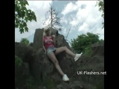 Teen blonde flashers outdoor striptease of young amateur exhibitionist Emma showing tits and expos.
