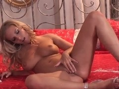 Adorable blonde Cikita plays with perfect tits