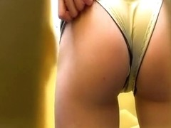 Chick in green shorts caught pissing