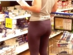 Yoga pants of a girl in the supermarket
