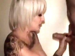 Inked amateur cuckold wife with big tits sucks off a hubby while taking another dick from behind