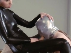 Female-Dom in shiny catsuit gives wang