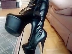 Zipping up and wearing Darksome Knee High Boots