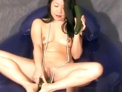 Beautiful Silk Star bends over and pleases her holes with a big dildo