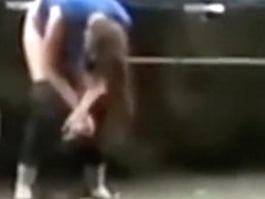 Desperate babe pees on a public suburban street