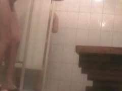 Fem with cool hips soaping skin on the shower cam