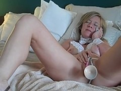 Mature wife on the phone and masturbating
