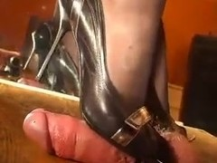 Awesome domina gives a shoejob through the gloryhole