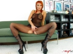 With a tattoo across her chest and bright red hair Leonie fell in love on our set with two cocks.