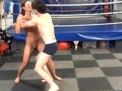 Muscle girl beats guy and makes him lick her pussy
