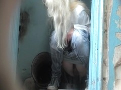Hidden cam shoots long haired blonde while pissing