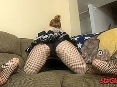 Redhead in fishnets pumps a stiff willie