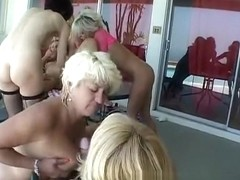 Mature lesbians in an orgy of pussy eating and strapon fucking