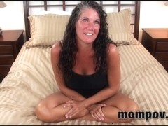 Curly mature sucks on a steely shaft